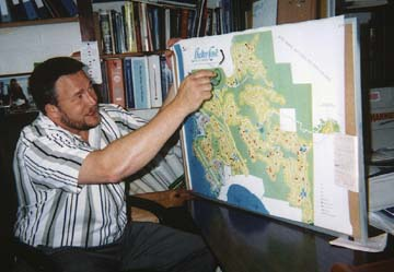 [photo of Richard Culp pointing to map of Shelter Cove]
